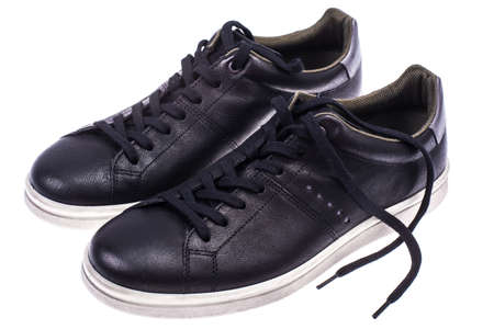 Black mens sneakers with white soles