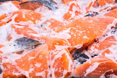 Slices of salmon frozen on ice Stockfoto