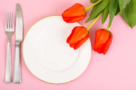 White plate, bouquet, bright pastel background