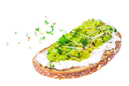Healthy eating. Multi-grain bread with avocado and sprouts cress lettuce
