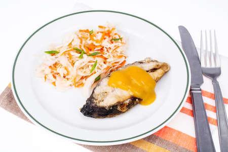 Fish fried, cabbage sauerkraut, lunch. Studio Photo