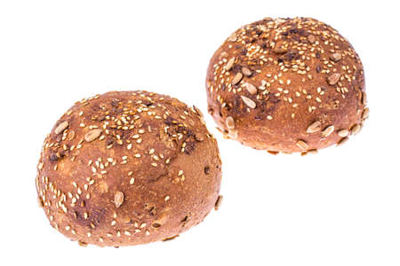 Round whole-wheat rye rolls with flax and sunflower seeds. Studio Photo