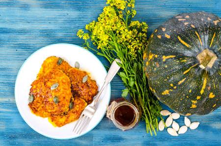 Plate of vegetable fritters, honey