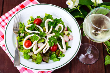 Dishes with seafood. Salad with squid