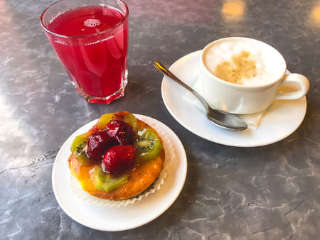 Cake, cappuccino and juice for lunch