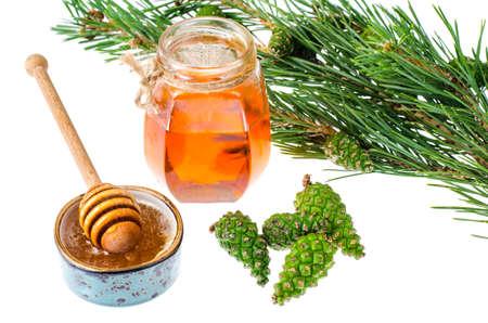 Honey from green pine cones. Studio Photo Imagens
