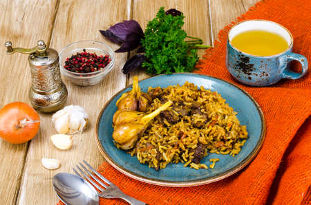 Blue plate with pilaf and meat. Studio Photo Stock Photo
