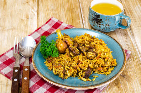 Blue plate with pilaf and meat.