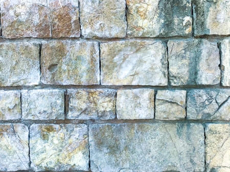Texture, background, wall of large natural, untreated stones