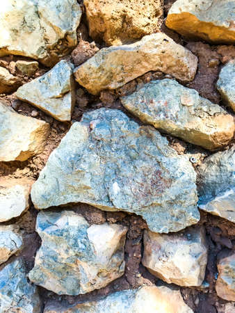 Texture, background, wall of large natural, untreated stones. Studio Photo