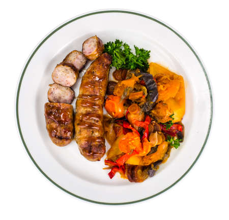Grilled sausages with baked vegetables. Stockfoto