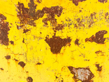 Rust on metal, painted in yellow paint.