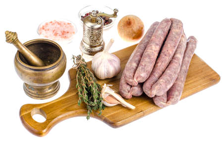 Raw homemade sausage in natural casing, spices, herbs for cooking. Studio Photo