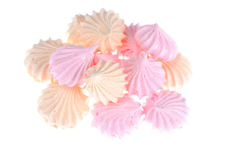 Small colored meringues on white background. Studio Photo