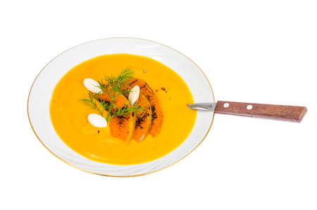 Creamy pumpkin cream soup. Studio Photo Stock Photo