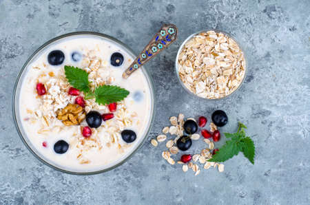 Healthy delicious muesli with oatmeal and pomegranat. Studio Photo