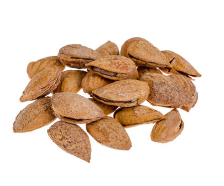 Heap of fresh unpeeled almonds isolated on white background.