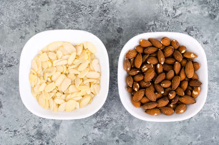 Whole, peeled and sliced almonds, top view.