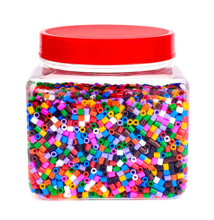 Jar with colored plastic pieces of childrens mosaic.