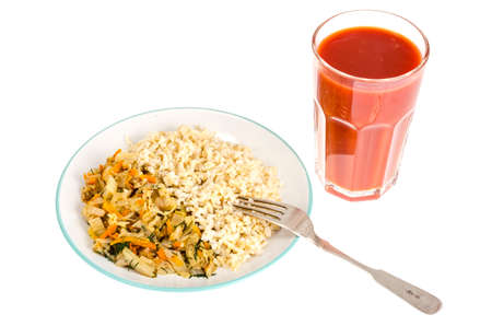 Vegetarian healthy food. Braised cabbage with carrots, brown rice. Studio Photo
