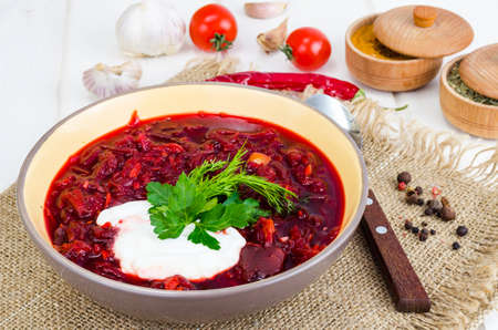 Delicious hot vegetable soup with beetroot, Russian borscht. Studio Photo Stock Photo