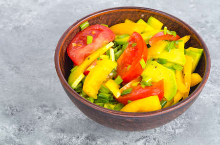 Avocado, sweet paprika, tomatoes, diet salad. Studio Photo 免版税图像