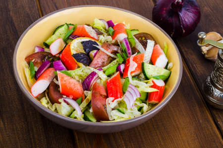 Vegetable salad with surimi crab sticks. Studio Photo