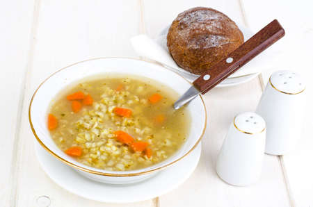 Vegetable broth with brown rice and carrots.
