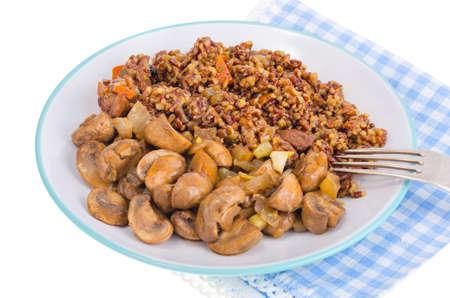 Vegetarian menu, red rice with champignons. Studio Photo