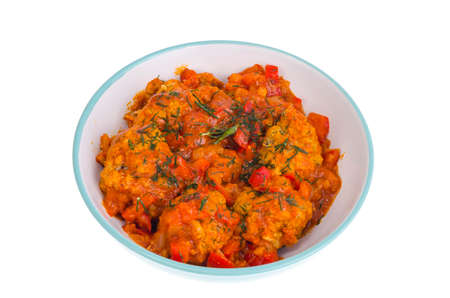Meatballs meat, fish in tomato sauce with vegetables.