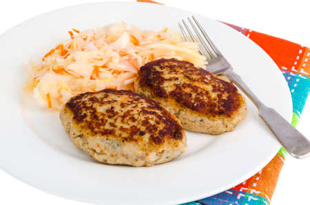 Pickled cabbage with cutlets oa white plate