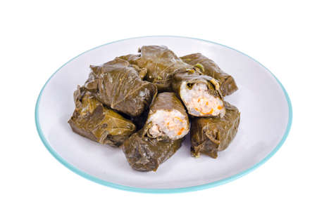 Dolma with meat and rice from grape leaves. Imagens