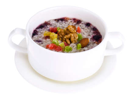 Healthy breakfast. Oatmeal with berries, nuts and candied fruit.