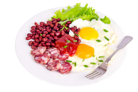 Red beans, lettuce and fried egg for breakfast.