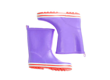 Childrens pink rubber boots for walking.
