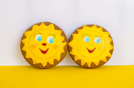 Two homemade gingerbread, cookies in shape of sun. Friendship day celebration concept. Studio Photo