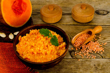 Vegetarian food, porridge with pumpkin and lentils.