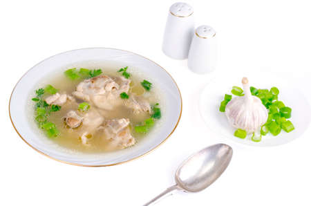 Broth with chicken meat Isolated on White background