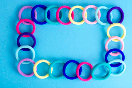 Colored hair ties on bright background. Photo Stockfoto