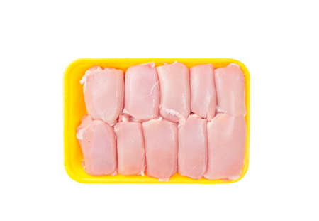 Raw chicken thigh meat without skin in tray. Studio Photo