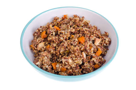 Red rice porridge with meat and vegetables.