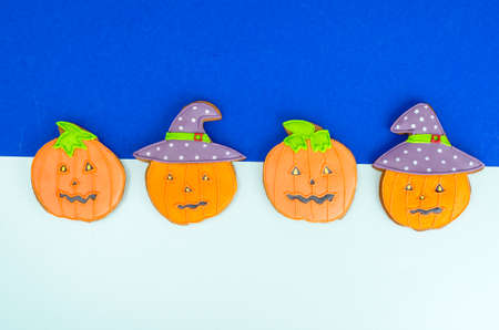 Bright Halloween pumpkin shaped gingerbread cookies.