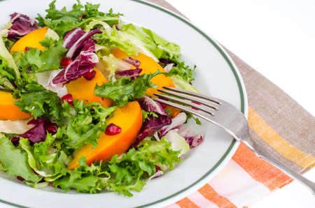 Salad with green leaves and persimmon 스톡 콘텐츠