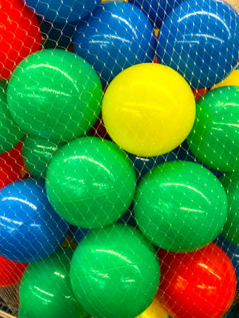 Plastic colored balls in grid