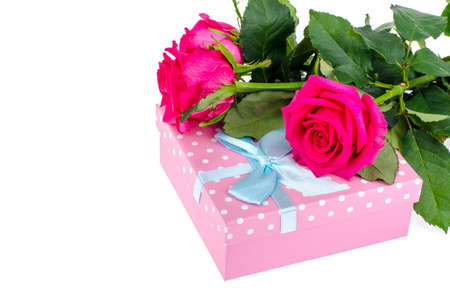 Beautiful bouquet of roses and gift box for holiday. Studio Photo