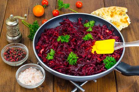 Dietary dishes. Stewed beet in frying pan Studio Photo
