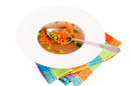 Dietary vegetable soup with carrots, peas and green onions.