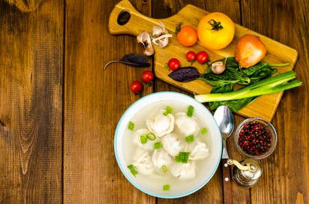 Hot broth with ravioli and green onions 版權商用圖片