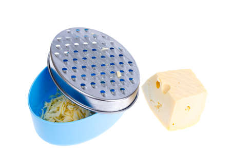 Container with metal cheese grater isolated on white background. Studio Photo