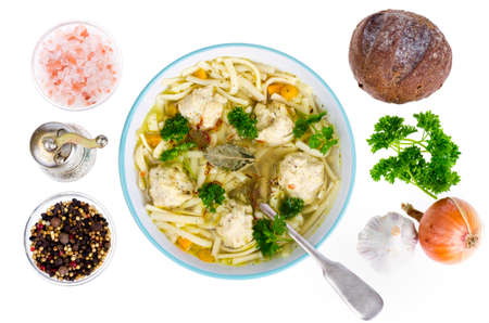 Chicken broth with egg noodles and meatballs. Stock Photo